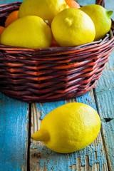 Fresh juicy lemons in a basket