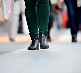 Shopping woman on sidewalk