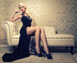 canvas print picture - beautiful girl sitting on a white sofa