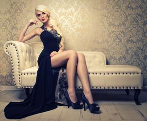 beautiful girl sitting on a white sofa