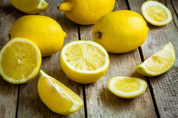 Fresh juicy lemons on a wooden background