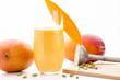 Leinwandbild Motiv Decorated Mango Lassie, Cardamom And Two Mangos