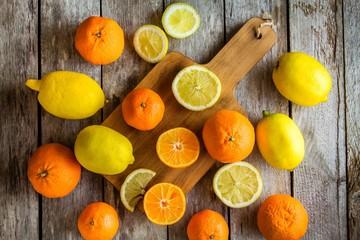 ripe mandarins and lemons on a cutting board