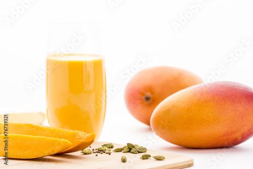 Leinwandbild Motiv Mangos, Cardamon And Mango Yoghurt Drink On White