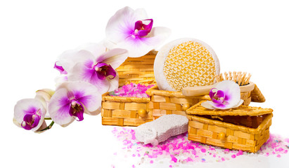 Spa concept. Twig orchid, boxes with salt and other accessories.