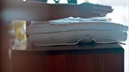 Putting two fresh towels on small table