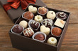 Delicious chocolate candies in gift box on table close-up - 76742742