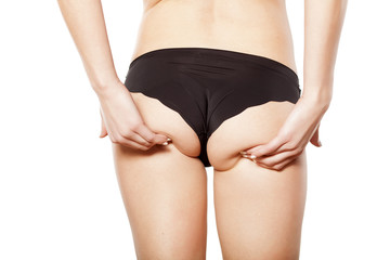woman lifted her buttocks with her hands