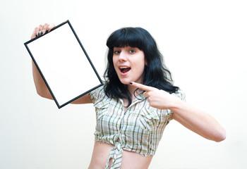 Smiling brunette girl pin up dress showing blank frame on white