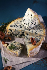 Blue cheese with sprigs of rosemary and nuts