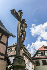 Old Cross and Jesus Christ Figure in Small City, Alsace