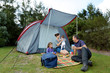 Family camping in a tent outdoors