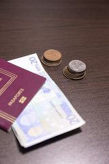 passport and cash on a table