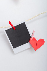 Blank instant photo with origami heart