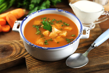 Composition with carrot soup, ingredients and herbs