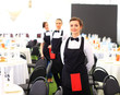 Large group of waiters and waitresses standing - 76747709