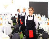 Large group of waiters and waitresses standing