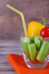 Sticks of celery with sweet pepper and cherry tomato in glass