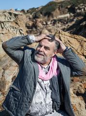 Man posing on mountain