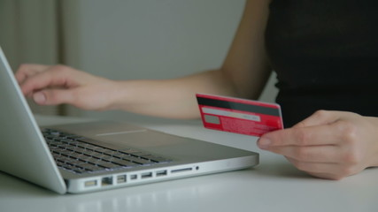 Woman makes a purchase in the online store with a credit card