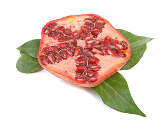 Half of pomegranate with green leaves on a white background.