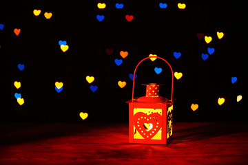 Romantic lantern on lights background, love concept