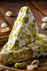 Turkish delight. Arabic dessert with and Pistachios on wooden