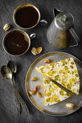 eastern traditional Pistachios dessert on gray background