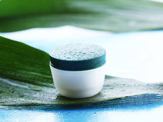 Cosmetic cream with water drops