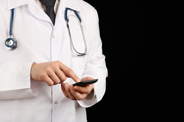 Doctor working with mobile phone on black background