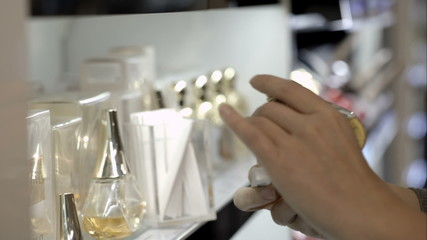 Woman in the shop choosing perfume with paper tester