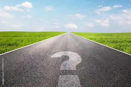 Leinwanddruck Bild Question mark symbol on long empty straight road, highway