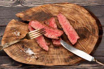 beef steak on wooden board