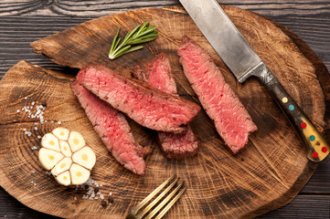 beef steak on wooden board
