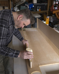 Man constructing woodworking project