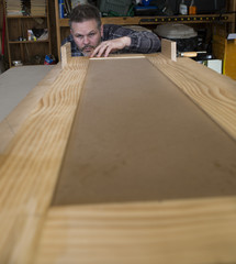 Man measuring woodworking project