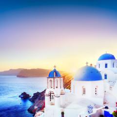 Oia town on Santorini Greece at sunset. Aegean sea
