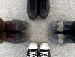 canvas print picture - Human shoes on asphalt