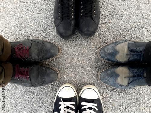 canvas print picture Human shoes on asphalt