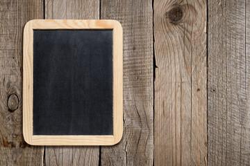 Empty blackboard on old wooden background