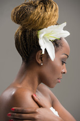 Sensual African woman lily flower in hair