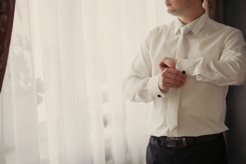men wear a shirt and cufflinks