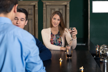 Young woman sitting at the bar alone