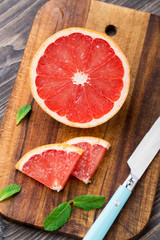 Grapefruit with slices on a table.