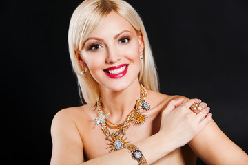 portrait of a beautiful smiling blonde model with luxury