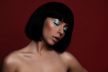 Close up portrait of fashion woman model with turquoise arrow