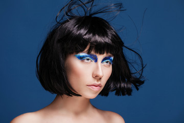 closeup beauty shot of young caucasian brunette with blue