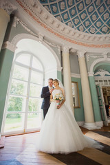 bride and groom embracing in the hall