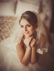 beautiful bride sitting in a room