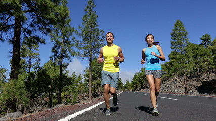 Running couple exercising living healthy lifestyle